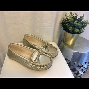 Gold Minnetonka moccasins, chic & sophisticated